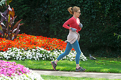 ©Licensed to London News Pictures 26/08/2020 Greenwich,UK. A jogger running in the flower garden. The calm after the storm as people enjoy a bright and sunny Greenwich park in Greenwich, London this afternoon. Photo credit: Grant Falvey/LNP