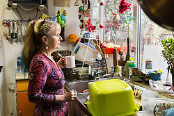 Artist Michelle Baharier, 55, in the kitchen of her 2 bedroom Camberwell flat where she is fighting payment demands by Southwark Council the freeholders, which she purchased in 2008 under the Right to Buy Scheme, for a boiler she says was imposed on her as part of a renovation theme. London, November 16 2018.