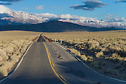 Highway going into distance between California and Nevada, USA
