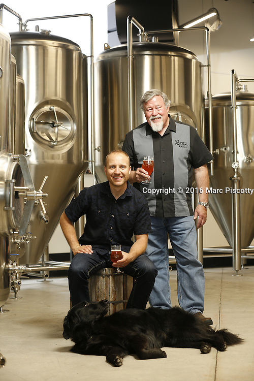 SHOT 7/22/16 2:15:36 PM - Bruz Beers co-founders Charlie Gottenkieny and Ryan Evans inside the new brewery near 67th Avenue and Pecos in Denver, Co. Bruz Beers is Denver's artisanal Belgian-style brewery, featuring a full line of traditional and Belgian-inspired brews, hand-crafted in small batches. Includes images of Evan's dog 'Cooper' as well who serves as the brewery dog. (Photo by Marc Piscotty / © 2016)