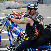 A Vietnam veteran participating in the annual Rolling Thunder motorcycle rally through downtown Washington DC on May 29, 2011. This shot was taken as the riders were leaving the staging area in the Pentagon's north parking lot, where thousands of bikes and riders had gathered.