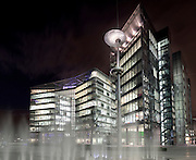 These 2 buildings known as 3 and 4 More London Riverside are occupied by Norton Rose and law firm Lawrence Graham. Seen at night with the fountains in the foreground.<br /> <br /> Architect: Fosters & Partners<br /> Co-architects: KSS Architects Limited