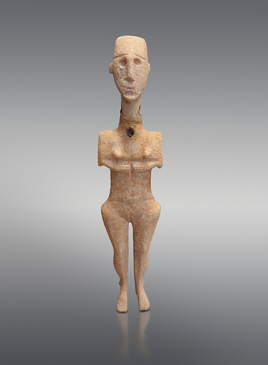 Cycladic statue figurine of the naturalistic 'Plastira' type of Paros. Early Cycladic Period I (Grotta-Pelos Phase 3200-2800 BC). National Archaeological Museum, Athens.   Grey background.<br /> <br /> <br /> This type of Cycladic figurine stand with feet lat to the ground with detailed facial features and ears to make a more realistic statue. .<br /> <br /> If you prefer to buy from our ALAMY PHOTO LIBRARY  Collection visit : https://www.alamy.com/portfolio/paul-williams-funkystock/cycladic-art-artefacts.html Type into the LOWER SEARCH WITHIN GALLERY box to refine search by adding background colour, place, museum etc<br /> <br /> Visit our CYCLADIC CIVILISATIONS PHOTO COLLECTIONS for more photos to download or buy as wall art prints https://funkystock.photoshelter.com/gallery-collection/Cycladic-civilisation-Ancient-Greek-Artefacts-art-Photos-Pictures-Images/C0000CmevVvnC.XU