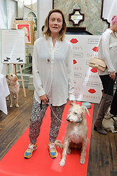 KATE SPICER and her dog at a party hosted by Lulu Guinness and Daphne's to launch Lulu's Designer Dog Bowl and to mark Daphne's allowing dogs through it's doors, held at Daphne's, Draycott Avenue, London on 28th June 2016.