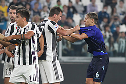 October 14, 2017 - Turin, Piedmont, Italy - Mario Mandzukic (Juventus FC) and Lucas LEIVA PEZZINI (SS Lazio) during the Serie A football match between Juventus FC and SS Lazio at Olympic Allianz Stadium on 14 October, 2017 in Turin, Italy. (Credit Image: © Massimiliano Ferraro/NurPhoto via ZUMA Press)
