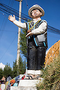 A statue of a boy welcomes visitors to Huaraz, in the Andes Mountains, Ancash Region, Peru, South America.