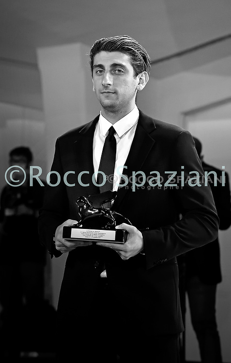 VENICE, ITALY - SEPTEMBER 12: Director Pietro Castellitto poses with the Orizzonti Award for Best Screenplay for the film 'I Predatori' the winners photocall at the 77th Venice Film Festival on September 12, 2020 in Venice, Italy.<br /> (Photo by Rocco Spaziani)