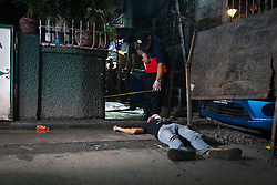 September 25, 2016 - Philippines - Scene of the Crime Operatives investivate the crime scene in Tondo, Manila. evidence beside   An alleged drug user was gunned down early Sunday morning in Tondo, Manila. The number of drug related killings has increased as the government continues its war on illegal drugs. (Credit Image: © J Gerard Seguia via ZUMA Wire)