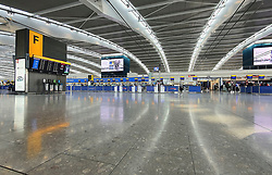 © Licensed to London News Pictures. 13/03/2020. London, UK. Heathrow's Terminal 5 remains quiet as flights are cancelled and passengers stay at home . New cases of the COVID-19 strain of the Coronavirus are being reported daily with major sporting fixtures cancelled and people advised to stay at home for seven days if they have a cough and or a high temperature. Photo credit: Peter Macdiarmid/LNP