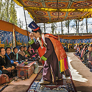 A Bagston ceremony.<br /> In the outskirts of Leh and facing the famous Thiksey monastery, a huge tent was erected. Small tables, beautiful examples of the Ladakhi tradition of wood carving, were placed for the guests. The guests sit on the floor, and butter tea, a must-have in Ladakh, is served to all. The couple had actually been together for more than ten years at the time of this wedding, and had two children together, a nine year-old daughter, and a four year-old son. The children attended their parents wedding. No third person, a priest or a Lama, is required to solemnize the wedding. A Ladakhi wedding is a simple case of making a decision and seeking the approval of parents. Later on, and this could be a month, a year or more, after they have decided, the pressure will start coming from the neighbors and family that wish to bless the couple. They will then organize a Bagston for which the couple will wear the traditional Ladakhi outfit. <br /> Ladakh, 2008