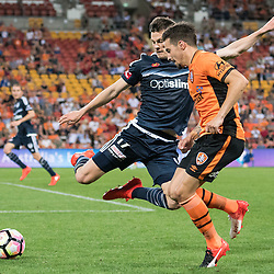 BRISBANE, AUSTRALIA - OCTOBER 7: James Donachie of the Victory tables Jamie MacLaren of the Roar during the round 1 Hyundai A-League match between the Brisbane Roar and Melbourne Victory at Suncorp Stadium on October 7, 2016 in Brisbane, Australia. (Photo by Patrick Kearney/Brisbane Roar)