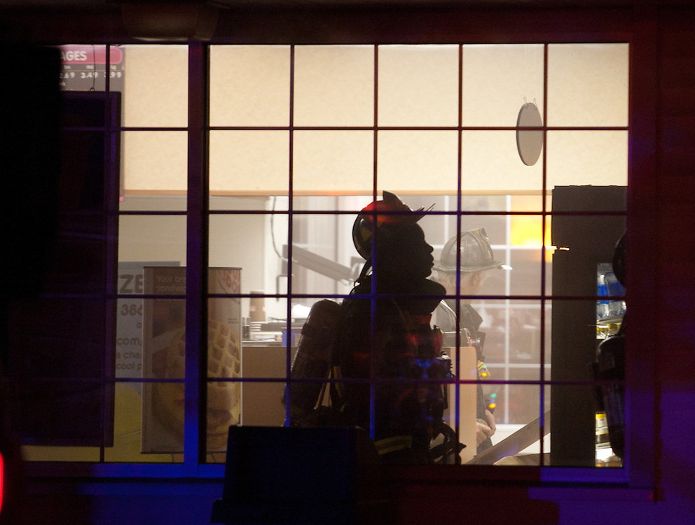 Boston, MA 5/26/11.Boston Firefighters extinguish a fire inside the Dunkin Donuts at 1630 VFW Parkway early Thursday morning.  The fire started in the rear of the building but was quickly contained, officials said..Alex Jones / For The West Roxbury Transcript