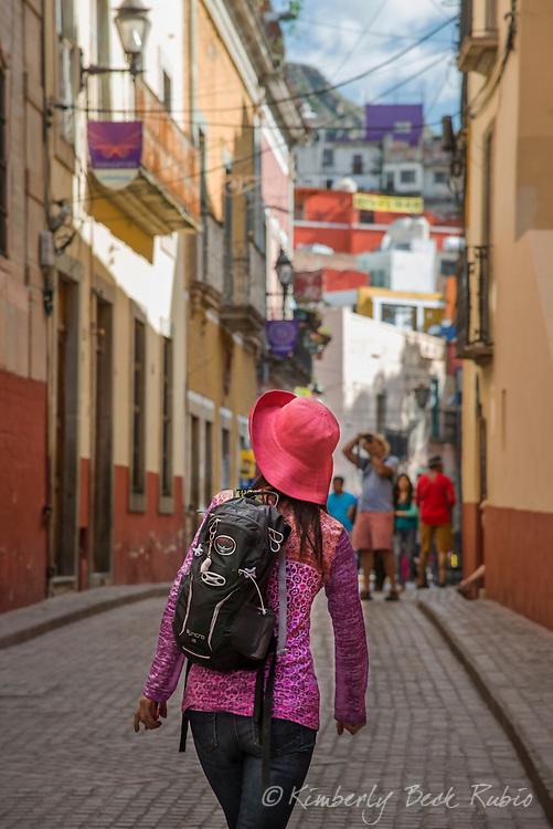 Tourist walking through the historic Colonial city of Guanajuato, Mexico