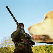 A 'gun' with his dog on a pheasant shoot, Swinton Estate, Nidderdale, North Yorkshire, UK