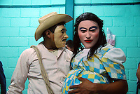"""MEXICO, Veracruz, Tantoyuca, Oct 27- Nov 4, 2009. Characters play their parts before a performance at the Preparatorio Benito Juarez in Tantoyuca. .""""Xantolo,"""" the Nahuatl word for """"Santos,"""" or holy, marks a week-long period during which the whole Huasteca region of northern Veracruz state prepares for """"Dia de los Muertos,"""" the Day of the Dead. For children on the nights of October 31st and adults on November 1st, there is costumed dancing in the streets, and a carnival atmosphere, while Mexican families also honor the yearly return of the souls of their relatives at home and in the graveyards, with flower-bedecked altars and the foods their loved ones preferred in life. Photographs for HOY by Jay Dunn."""