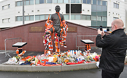 A fan takes a picture of the Jimmy Armfield tribute