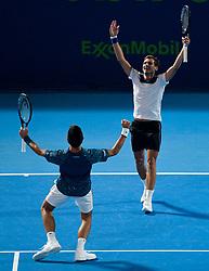 Novak Djokovic (L) and brother Marko Djokovicof (R) Serbia celebrate winning against Mubarak Shannan Zayid of Qatar and Cem ?lkel of Turkey in their men's first round doubles match of the ATP Qatar Open Tennis at the Khalifa International Te?nnis Complex in Doha, capital of Qatar, on December 31, 2018. Djokovic brothers won 2-0  (Credit Image: © Yangyuanyong/Xinhua via ZUMA Wire)