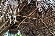"""A Halau Wa'a, or Hawaiian canoe house, has been reconstructed on historic foundations in Waimea Valley, a cultural nature park with botanical gardens, at 59-864 Kamehameha Highway, Haleiwa, on the North Shore of island of Oahu, Hawaii, USA. Formerly known as """"Waimea Valley Audubon Center,"""" since 2008 the garden has been managed by Hi'ipaka LLC, a non-profit company created by the Office of Hawaiian Affairs. Hawaii is the northernmost island group in Polynesia. Before it was made a state of the USA in 1959, Hawaii was previously an 1810 kingdom, 1893 protectorate, 1894 republic, and 1898 territory."""