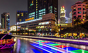 Sept. 2015 Singapore:  The streak of colored lights of boats going down the river at Riverside night scene of buildings at Clarke Quay, Singapore. Photographed with lower iso RAW to Jpg