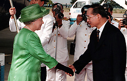 The Queen is greeted with great ceremony by the Thai King, Bhumibol, at Bangkok airport, after her arrival. John Stillwell Pool