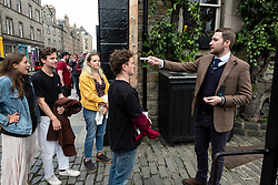 Pictured:   Security man Johnathon Bayley checks Ben, Rupert, Olina and Bella's (mustard jacket) temperature before they were allowed into the Pear Tree garden.<br /> <br /> Pubs with beer gardens are back in action in Scotland from today.  The Pear Tree and 56 North in Edinburgh asked customers to book socially distanced tables for two-hour slots.  This is to protect staff and customers alike.  All details of booked clients are retained and temperatures taken before anybody is permitted in the Covid 19 free zone. Operations manager for the Pear Tree, Brian Dobie was keen to show customers that the bar was taking their responsibilities seriously with only table service for all food and drink.  Any walk up customers to 56 North have to provide their contact details to ensure any health issues can be traced if required.