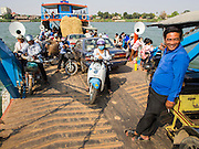 26 FEBRUARY 2015 - PHNOM PENH, CAMBODIA:  Passengers on a ferry crossing the Mekong River from the outskirts of Phnom Penh.   PHOTO BY JACK KURTZ