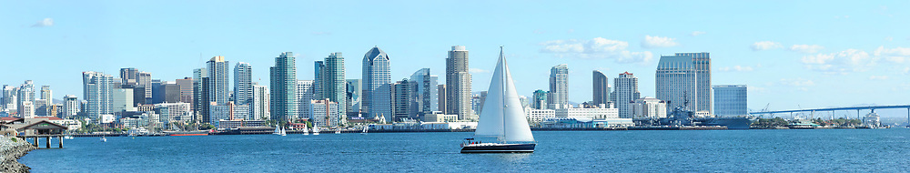 Ultra wide view of the downtown San Diego skyline with sailboat in foreground. <br /> <br /> Panoramic available up to 21696 x 4112.