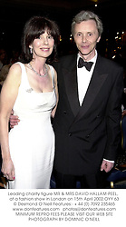 Leading charity figure MR & MRS DAVID HALLAM-PEEL,  at a fashion show in London on 15th April 2002.OYY 63