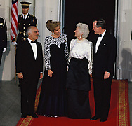 Washington, DC 1989/04/01 President H.W. Bush (Bush 41), and King Hussein of Jordan.  A photo session at the North Portico  of the White House before a state Dinner.  (left to right: King Hussein, Queen Noor of Jordan, Barbara Bush President H.W. Bush<br />Photo by Dennis Brack