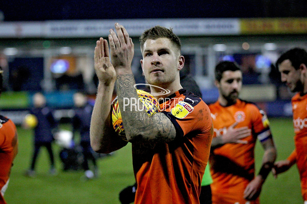 Luton Town FC forward James Collins (19) claps the fans while holding the match ball after the EFL Sky Bet League 1 match between Luton Town and Peterborough United at Kenilworth Road, Luton, England on 19 January 2019.