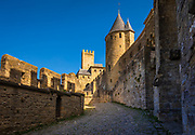 Carcassonne is a French fortified city in the department of Aude, in the region of Occitanie. A prefecture, it has a population of about 50,000.<br /> <br /> Inhabited since the Neolithic period, Carcassonne is located in the plain of the river Aude between historic trade routes, linking the Atlantic to the Mediterranean Sea and the Massif Central to the Pyrénées. Its strategic importance was quickly recognized by the Romans, who occupied its hilltop until the demise of the Western Roman Empire. In the fifth century, it was taken over by the Visigoths, who founded the city. Its strategic location led successive rulers to expand its fortifications until the Treaty of the Pyrenees in 1659.<br /> <br /> Its citadel, known as the Cité de Carcassonne, is a medieval fortress dating back to the Gallo-Roman period and restored by the theorist and architect Eugène Viollet-le-Duc in 1853. It was added to the UNESCO list of World Heritage Sites in 1997. Consequently, Carcassonne relies heavily on tourism but also counts manufacturing and wine-making as some of its other key economic sectors.