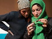 Angoma doing her nails. In Roshorv village.