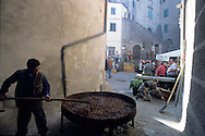Cooking chestnuts by a traditional manner during a Chestnut festival of Arcidosso