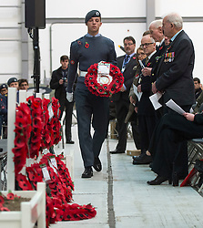 © Licensed to London News Pictures. 08/11/2015. Duxford, UK. A wreath being placed by an air cadette during an official service of Remembrance and wreath laying ceremony at Imperial War Museum Duxford, Cambridgeshire on Remembrance Sunday 2015. . Photo credit: Ben Cawthra/LNP