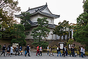 School tour group. Nijo Castle (Nijo-jo) was built in 1603 as the Kyoto residence of Tokugawa Ieyasu, the first shogun of the Edo Period (1603-1867). His grandson Iemitsu completed the castle's palace buildings 23 years later and further expanded the castle by adding a five-story castle keep. After the Tokugawa Shogunate fell in 1867, Nijo Castle was used as an imperial palace for a while before being donated to the city and opened to the public as a historic site. Its palace buildings are some of the best surviving examples of castle palace architecture of Japan's feudal era, and the castle was designated a UNESCO world heritage site in 1994.