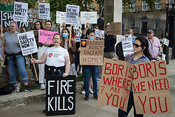 Leaseholders and tenants living in unsafe homes protest opposite Downing Street on 15th July 2021 in London, United Kingdom. Some leaseholders are faced with crippling costs to fix safety issues and they called on the government to ensure that their homes are made safe from fire as a matter of priority, to make interim payments and to cover fire safety remediation costs and to find a solution with mortgage lenders which enables them to move on with their lives.