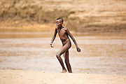 Young Nyangatom boy in the river. Omo Valley, Ethiopia