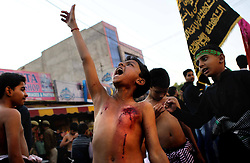 60700868 <br /> A young Shiite Muslim mourner shouts slogans during a Muharram procession in Jammu, the winter capital of Indian-controlled Kashmir, Nov. 11, 2013. Shiite Muslims all over the world mourn the slaying of Imam Hussein, grandson of Prophet Mohammad, during Islamic month of Muharram, Monday, 11th November 2013. Picture by  imago / i-Images<br /> UK ONLY