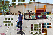 GUADALAJARA, MEXICO - MAY 11, 2017: A man walks behind a crystal that is used to assign and organize the activities in Wizeline. Wizeline transforms how business design, develop and deliver technology products. Rodrigo Cruz for The New York Times
