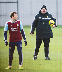 © London News Pictures. 28/01/2014. London, UK. Manager SAM ALLARDYCE (right) and MARK NOBLE (left) during West Ham United training at their training ground in Chadwell Heath, East London ahead of their premiership game away to Chelsea on tomorrow night (29/01/2014). Photo credit: Ben Cawthra/LNP