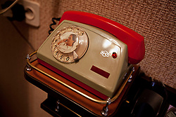 A telephone inside the home of Mykola Shevchuk, 74, and Olga Shevchuk, 70, after a Òspecial consultationÓ held by attorneys and paralegals for potential clients who are children of the Second World War, Rivne, Ukraine, June 16, 2011. This vulnerable group is made up of seniors, most of whom are not receiving proper compensation as promised by the government. The legal team advises them on how to properly fill out forms and submit them to the courthouse, while encouraging them not to give up on their rights. More than half of the worldÕs population, four billion people, live outside the rule of law, with no effective title to property, access to courts or redress for official abuse. The Open Society Justice Initiative is involved in building capacity and developing pilot programs through the use of community-based advocates and paralegals in Sierra Leone, Ukraine and Indonesia. The pilot programs, which combine education with grassroots tools to provide concrete solutions to instances of injustice, help give poor people some measure of control over their lives.