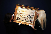 Christie's auction house employees hold up 'The Playground', a painting by British artist L.S. Lowry which along with twenty other works by the artist will be auctioned at Christie's.The painting is regarded as the most valuable in the collection with an estimated value of between 500,000 and 700,000 pounds, London.