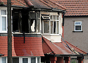 © Licensed to London News Pictures. 23/09/2011. LONDON, UK. The upper floor of the property were badly damaged. Six people, including three children, two teenagers and an adult have died following a house fire in Neasden, North West London today (24 Sept 2011). Emergency services were called tot he blaze in the early hours of the morning. Photo credit:  Stephen Simpson/LNP