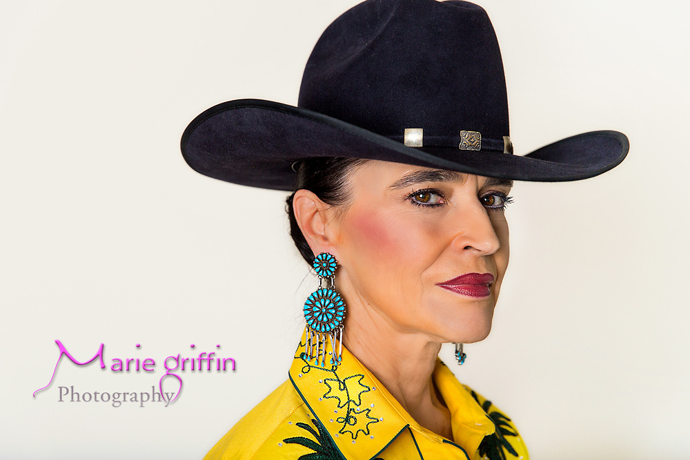 Koncilja wears an O'Farrell cowboy hat.  Owning one is a big deal. Each O'Farrell is custom made and measured to fit just the owner's head. O'Farrell's are considered the finest cowboy hats on the market. Frances Koncilja part of Denver Rustlers models her western wear in her office on Aug. 18, 2014. Story featured for Colorado Statesman.<br /> Photography by: Marie Griffin Dennis<br /> mariegriffinphotography.com<br /> mariefgriffin@gmail.com