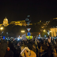 Participants hold their phones in the air to protest against the planned Internet tax in Budapest, Hungary on October 28, 2014. ATTILA VOLGYI