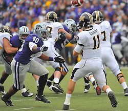 Nov 14, 2009; Manhattan, KS, USA; Missouri quarterback Blaine Gabbert (11) throws the pass before taking a hit from Kansas State defensive end Antonio Felder (40) at Bill Snyder Family Stadium. The Tigers won 38-12. Mandatory Credit: Denny Medley-US PRESSWIRE