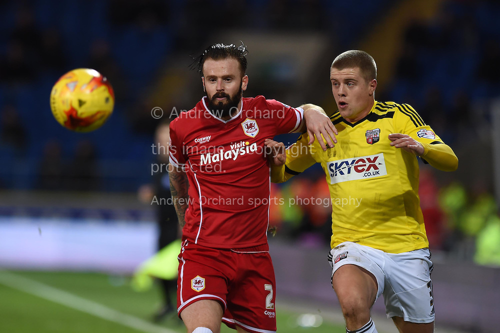 John Brayford of Cardiff city (l) holds off Brentford's Jake Bidwell. Skybet football league championship match, Cardiff city v Brentford at the Cardiff city stadium in Cardiff, South Wales on Saturday 20th December 2014<br /> pic by Andrew Orchard, Andrew Orchard sports photography.