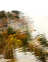 Thinking about the transition from fall to winter using a double exposure combining the top of Gunstock Mountain and the snowmaking pond.  (Karen Bobotas/for the Laconia Daily Sun)