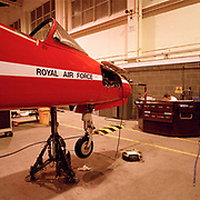 Scheduled maintenance on a Hawk Mk 1 jet in the hangar of the Red Arrows, Britain's RAF aerobatic team. Engineering specialists called the Blues perform routine maintenance in the Red Arrows team hangar. They are ground-based back-up crew (so-called after their distinctive blue overalls worn only during the summer) and perform routine engineering tasks in the hangar at RAF Scampton, then while on tour, keeping the jets serviceable and ready to display. The Blues outnumber the pilots 8:1. Without them, the Red Arrows couldn't fly. Some of the team's Hawks are 25 years old and their air frames require constant attention, with increasingly frequent major overhauls due.