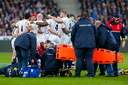 England player including Flanker James Haskell (facing) huddle together as Hooker Dylan Hartley (capt) is placed on a stretcher - Mandatory byline: Rogan Thomson/JMP - 19/03/2016 - RUGBY UNION - Stade de France - Paris, France - France v England - RBS 6 Nations 2016.
